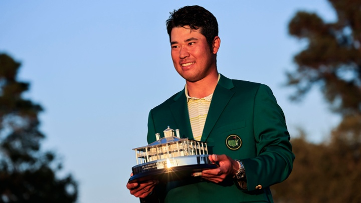 Hideki Matsuyama of Japan is awarded the Masters Trophy and the Green Jacket during the Green Jacket Presentation Ceremony following the final round of the Masters at Augusta National Golf Club, Sunday, April 11, 2021.