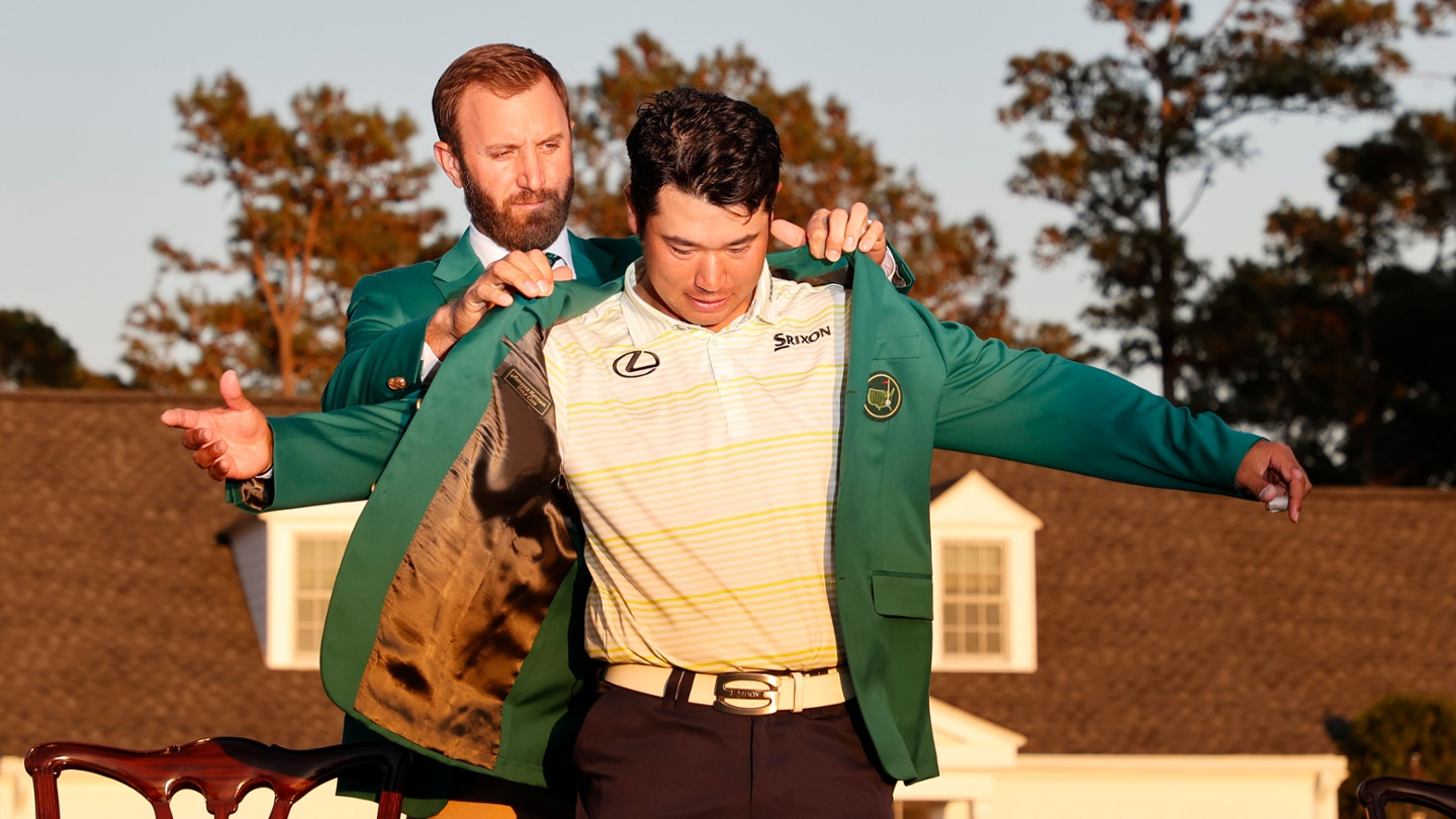 Hideki Matsuyama is awarded the Green Jacket by Masters champion Dustin Johnson after winning the 2021 Masters. image