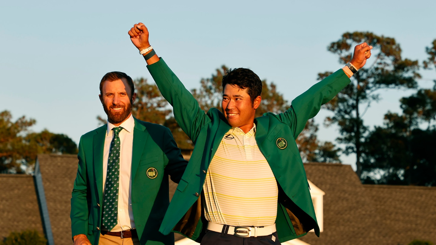 Hideki Matsuyama celebrates after being awarded the Green Jacket by Masters champion Dustin Johnson for winning the 2021 Masters. image