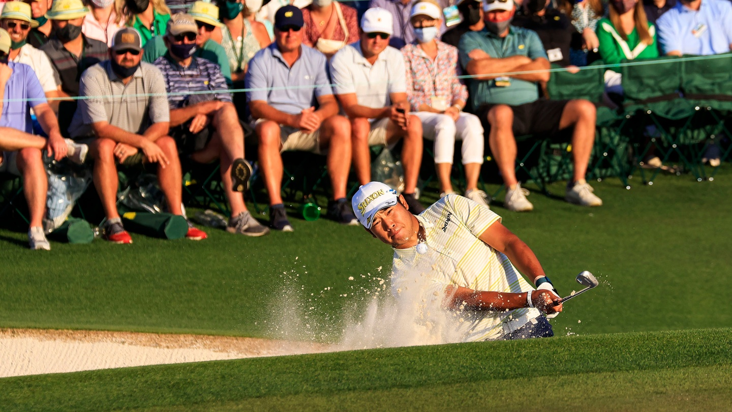 Hideki Matsuyama plays from a greenside bunker at No. 18 during the final round of the 2021 Masters. image
