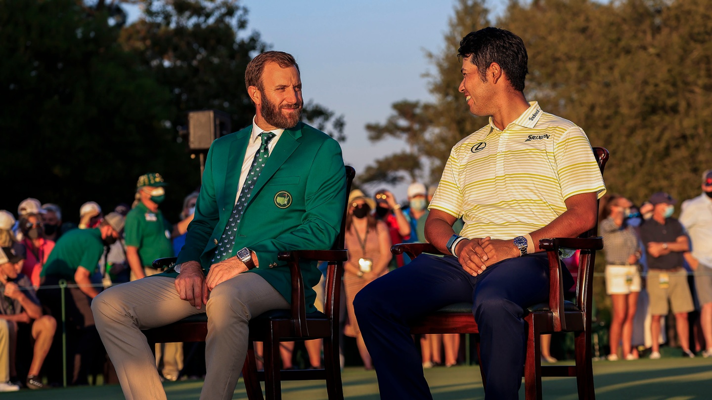 Masters champion Dustin Johnson and Hideki Matsuyama of Japan share a moment during the Green Jacket Ceremony following Matsuyama's win at the 2021 Masters. image