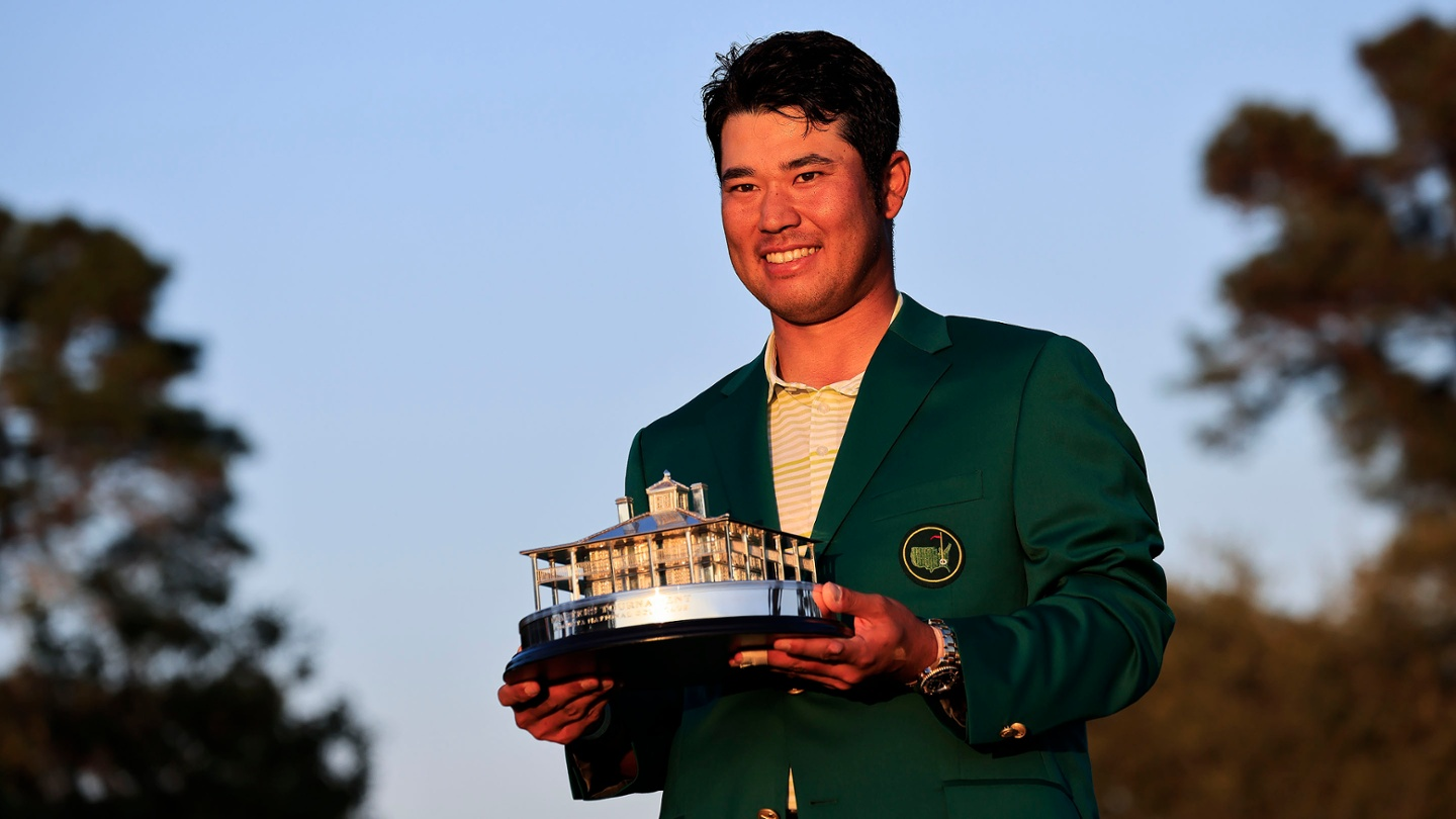 Hideki Matsuyama poses with the Masters Tournament Trophy after winning the 2021 Masters. image