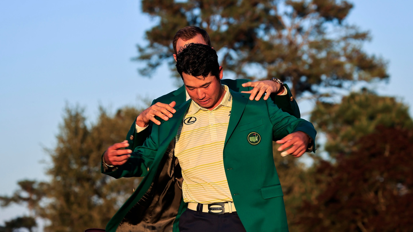 Hideki Matsuyama receives the Green Jacket from Masters champion Dustin Johnson after winning the 2021 Masters. image