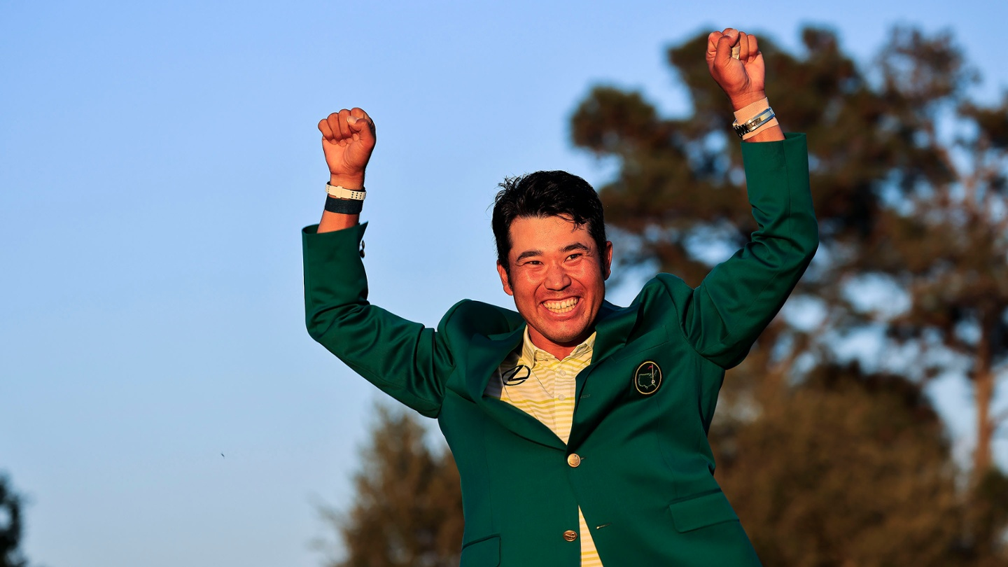 Hideki Matsuyama celebrates after being awarded the Green Jacket following the final round of the 2021 Masters. image