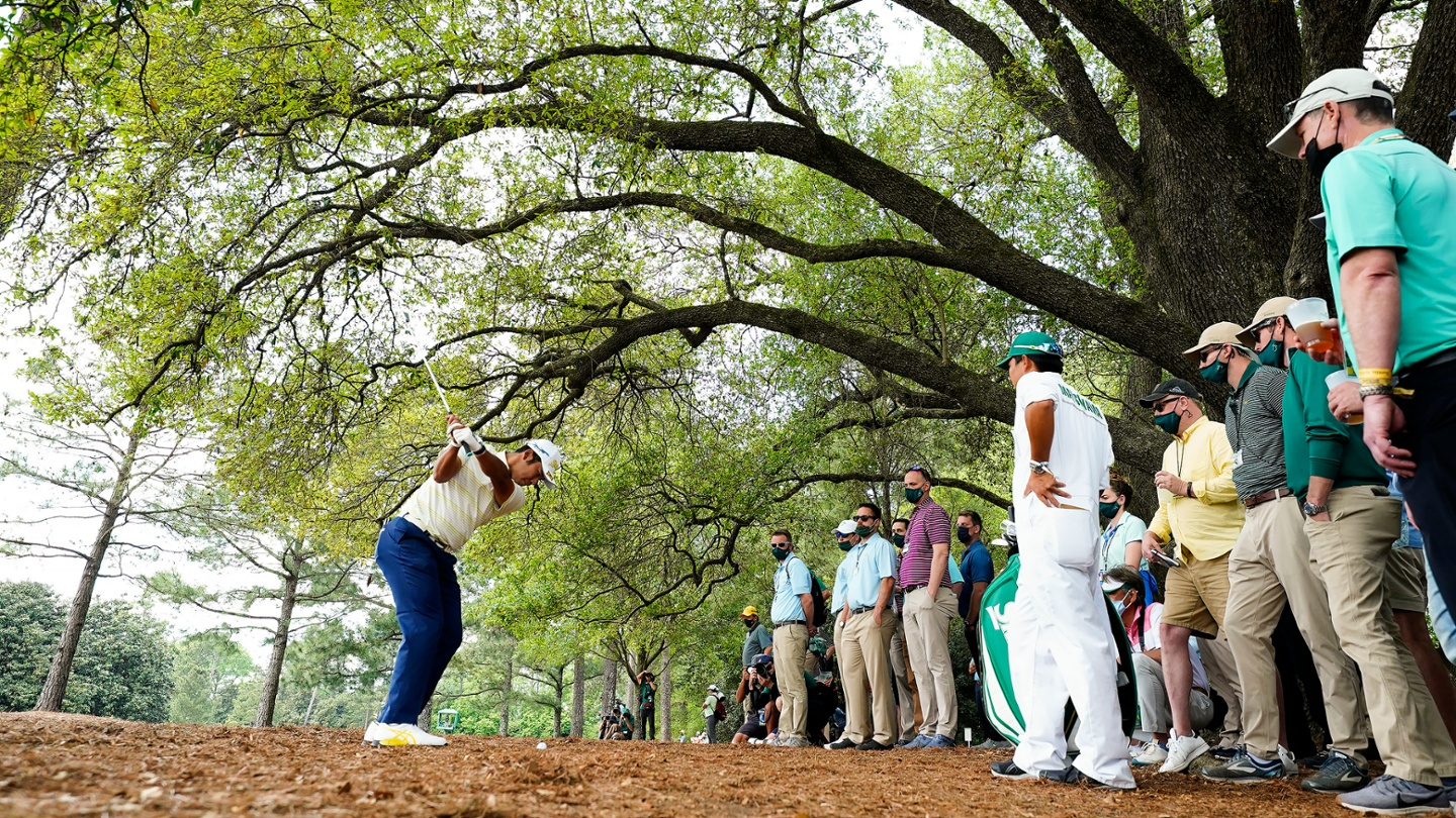 Hideki Matsuyama plays from the pine straw at No. 1 during the final round of the 2021 Masters. image