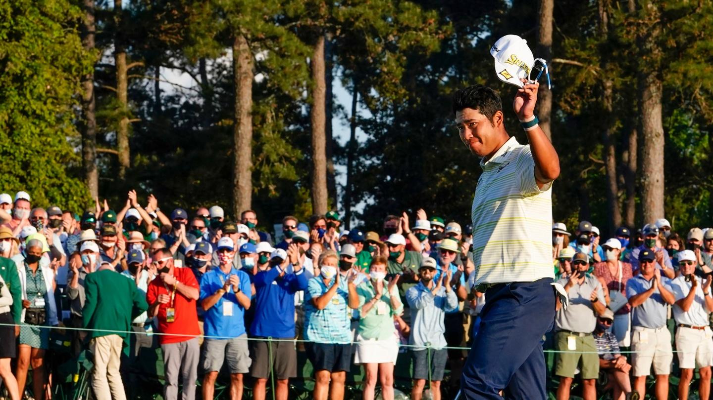 Hideki Matsuyama waves to the patrons after winning the 2021 Masters. image