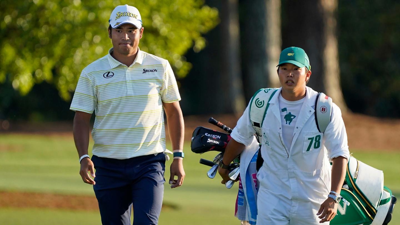 Hideki Matsuyama walks to the No. 18 green with caddie Shota Hayafuji during the final round of the 2021 Masters.