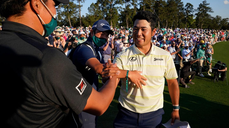 Hideki Matsuyama is congratulated after winning the 2021 Masters Tournament. image