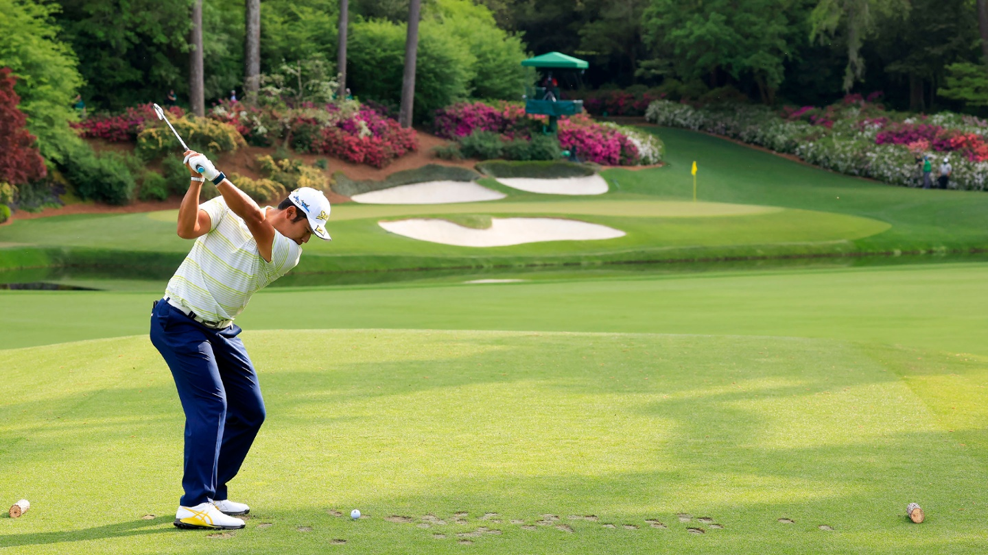 Hideki Matsuyama plays from the No. 12 tee during the final round of the 2021 Masters. image