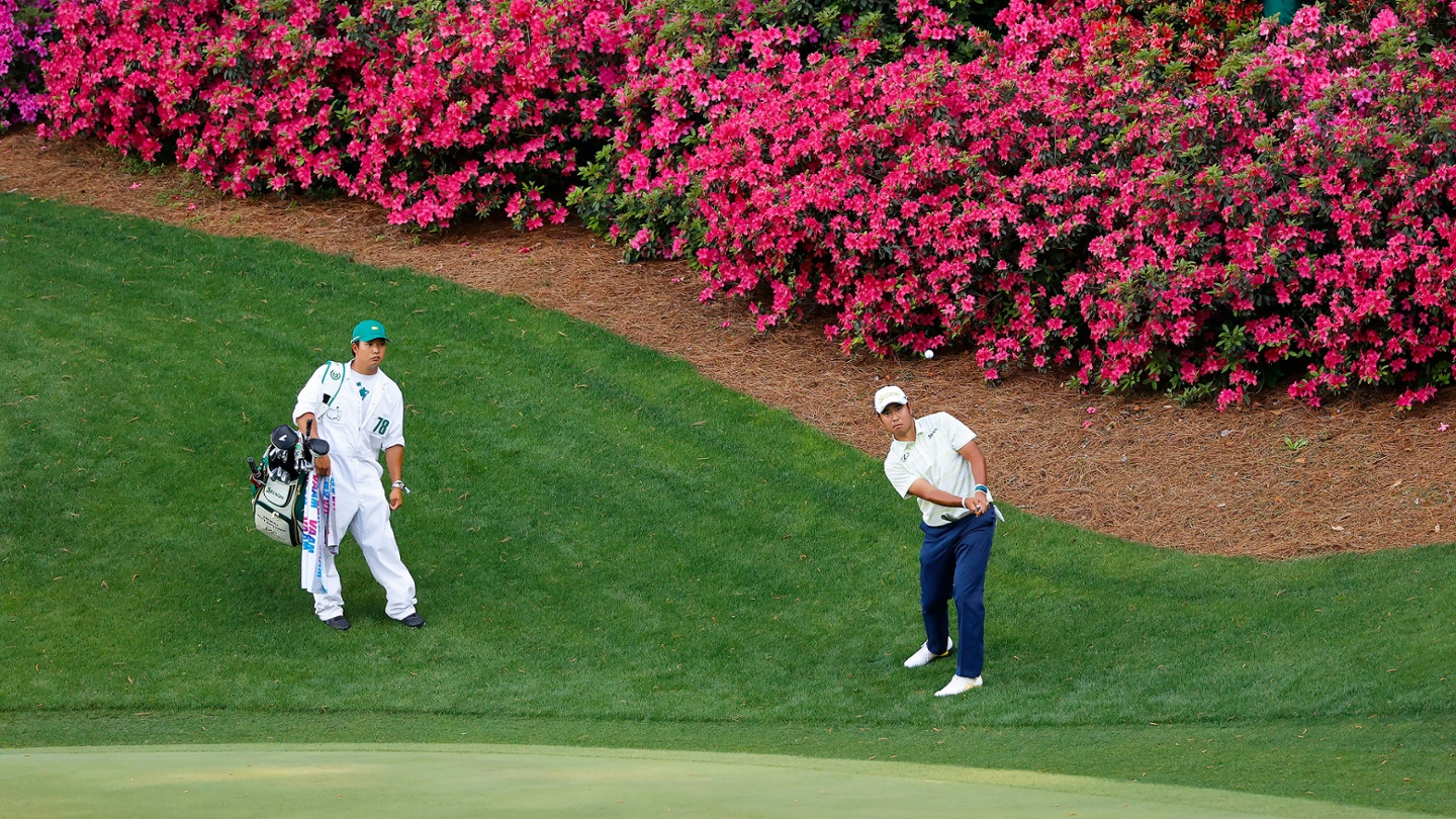 Hideki Matsuyama chips to the No. 13 green during the final round of the 2021 Masters. image