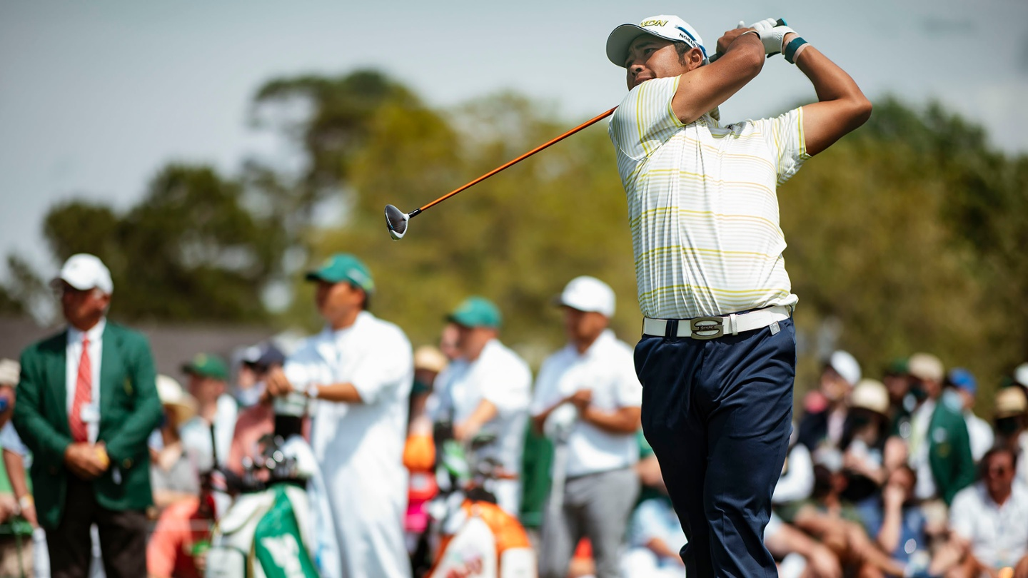 Hideki Matsuyama tees off at No. 1 during the final round of the 2021 Masters. image
