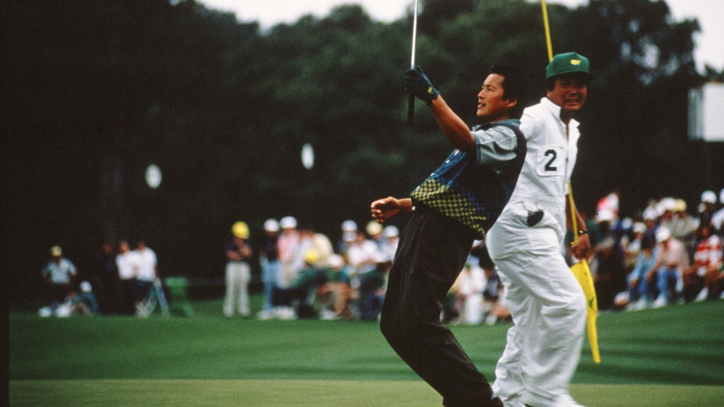 """Japan's Masashi """"Jumbo"""" Ozaki reacts with his caddie during the 1990 Masters Tournament at Augusta National Golf Club. image"""