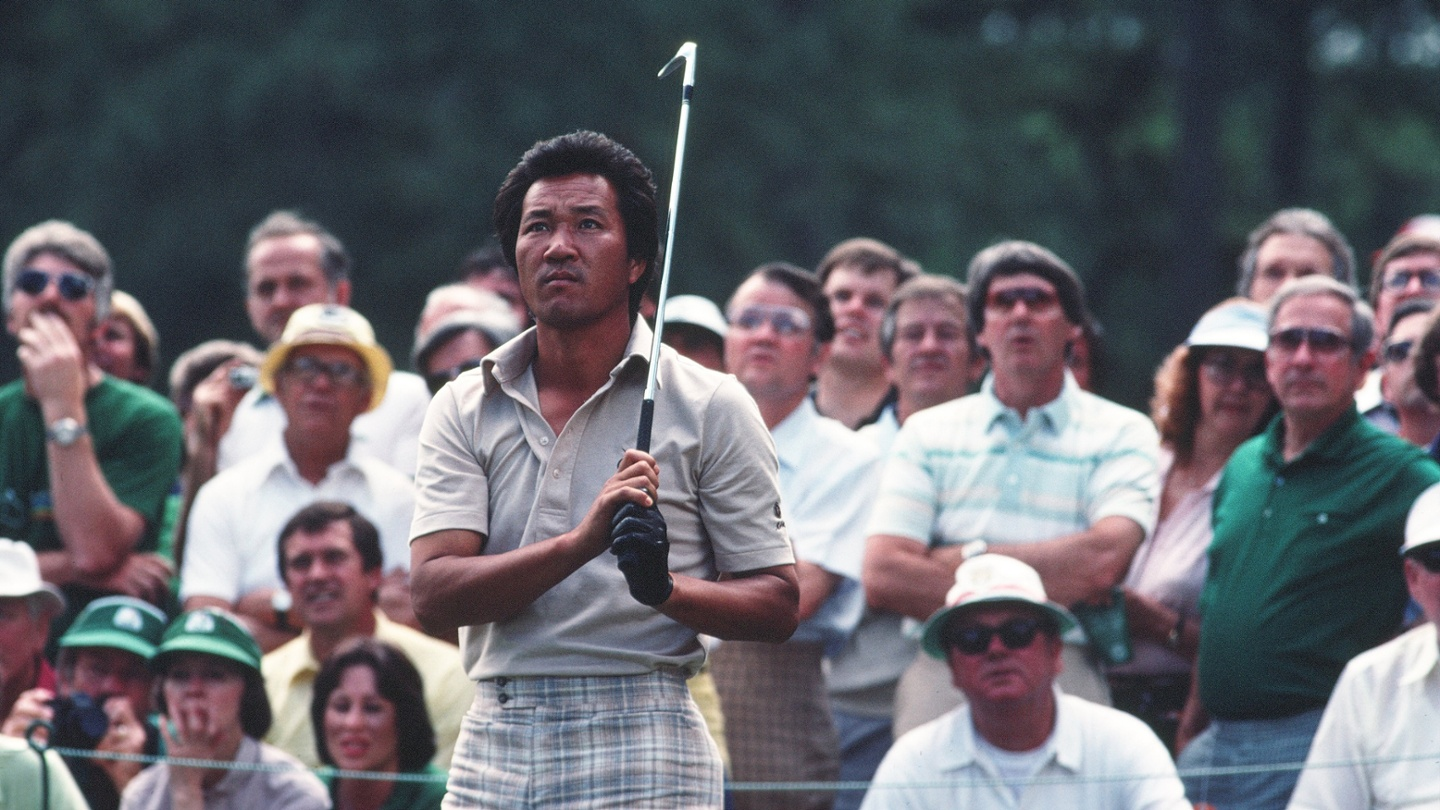 Isao Aoki and patrons follow his shot during the 1981 Masters Tournament at Augusta National Golf Club. image